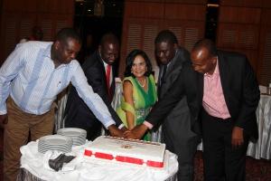 L to R Dr Hassan Wariro Arero, Hon. William Ruto, Hon. Sunjeev Birdi, Hon. Sakaja Johnson, Hon. Aden Duale cut the 50 Years Kenya Cake