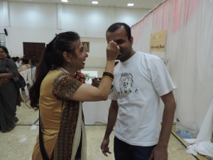 L to R Art of Living Kenya's Devna Nagda puts the Tilak on Madhusudhan Mondal