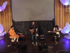 On Stage L to R Bob Gosh, Vikram Hazra, Mizo Dos