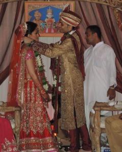 L to R Bride Shaini Vishram, Groom Tushar Khoda, The Priest looks on