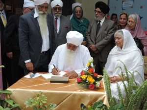 Bhai Sahib Ji Signs the School Visitors Book