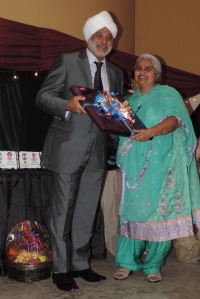 L to R Mr Ravinder Singh receives gift from Chairwoman Sikh Women Society Mrs Inderjeet Rehal