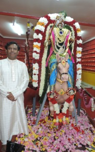 Chairman Pamidimukkala Sambasiva Rao with the temple deity- Sri Kalyana Venkateswara.