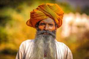 man wearing orange headdress